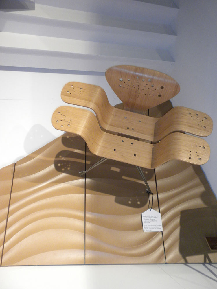 Designed as a prototype by Caroline Trudeau while at l'Ecole Nationale de Meuble, the <i>Dragonfly</i> chair was made of bamboo and hand-drilled to attain its detals. The two strips that comprise the seat were bent together as a singular sheet and cut int