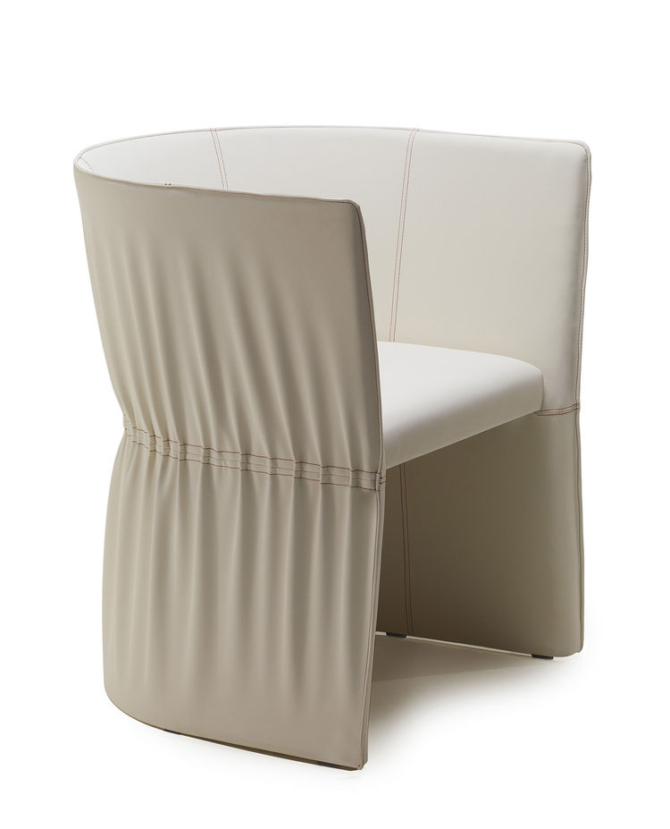 "<a href=""http://www.garsnas.se/en-GB/Products/easy-chairs/Dress-4693"">Dress chair</a> for Gärsnäs. ""This is my latest design for Gärsnäs. It's an armchair or easy chair. In my studio, I have my computer, drawing board, and sewing machine, which is as impo"
