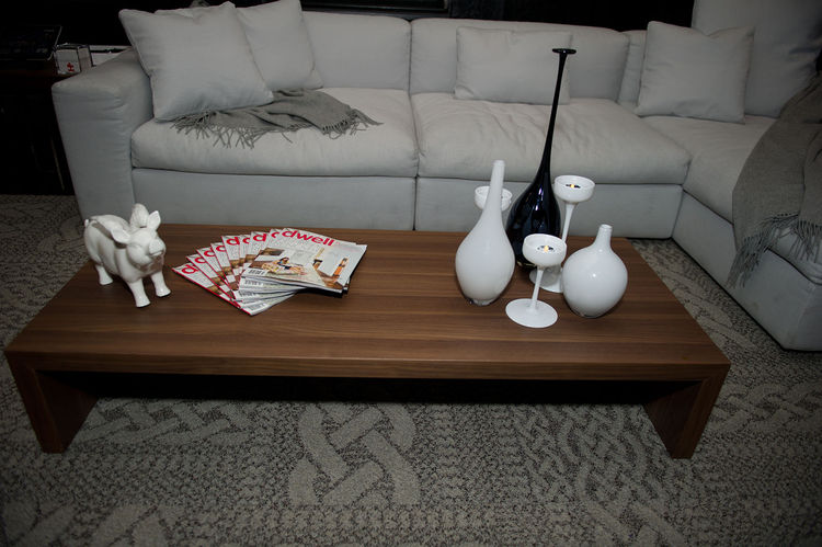 A fan of Dwells adorn the Ala bench from Poliform with tabletop accents from Z Gallerie.