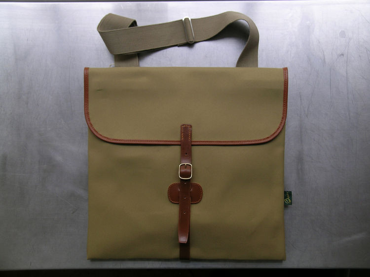 "<b>Folio Bag</b> ""An archive design selected from the manufacturer's archive. We love the traditional craftsmanship, combined with a contemporary look. Very useful for carrying a laptop."" Photo courtesy of Labour and Wait."