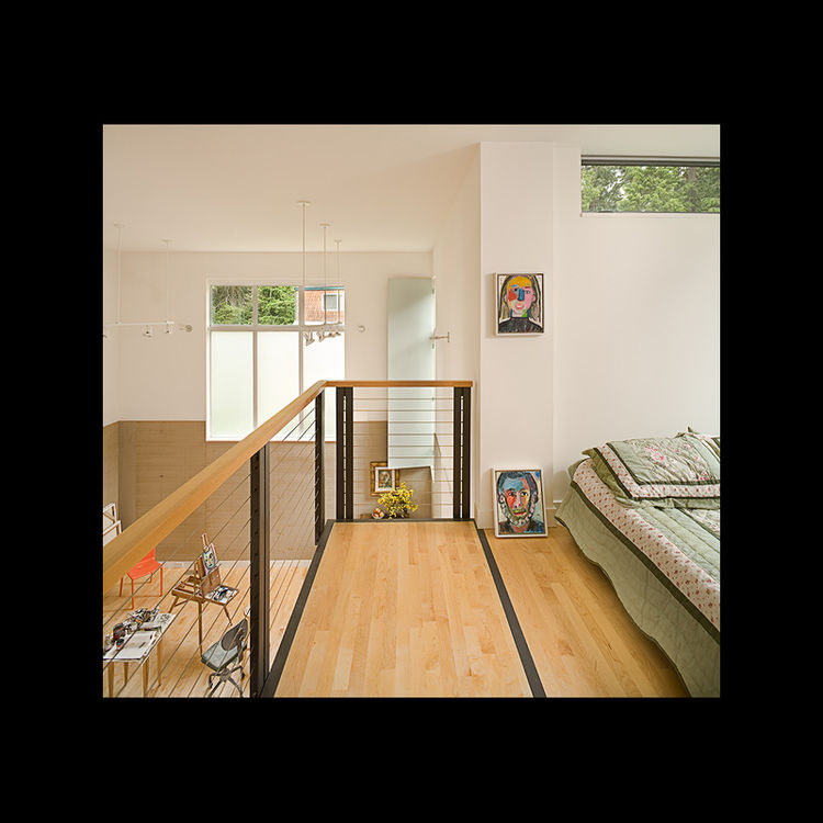 The second floor also houses a guest sleeping loft above the studio that can, like the studio, be shut off from the rest of the house by closing the interior garage door. Photo by Benjamin Benschneider Photography.