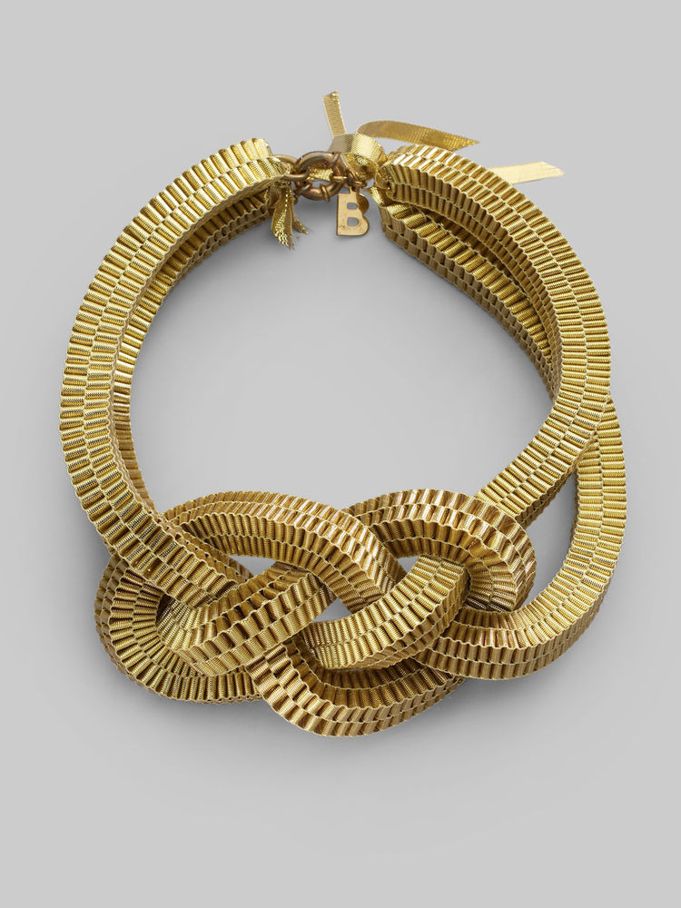"<a href=""http://www.behnazsarafpour.com/"">Behnaz Sarafpour</a> was one of two finalists for the Fashion Design Award. Pictured here is Sarafpour's Gold Knotted Ribbon Necklace. Photo by Saks Fifth Avenue."