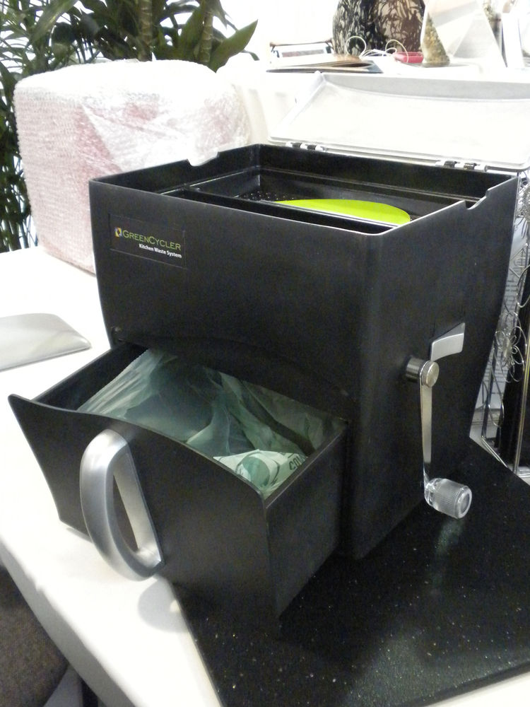 "Also on display was the <a href=""http://thegreencycler.com/"">GreenCycler</a> a new product that is just now accepting pre-orders. The countertop container holds up to three gallons of compost in its pull-out bottom bin, with which you can line with a comp"