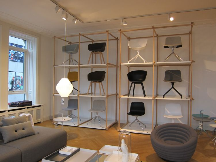 A grid-like display of chairs, with the upholstered foam Blow Chair by Foersom & Hiort-Lorenzen in the foreground.