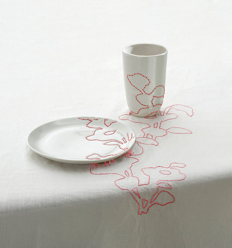 <h2><p>1999</h2></p><p>Embroidered Tablecloth continues patterns derived from Ming vases across plates and cups.</p>