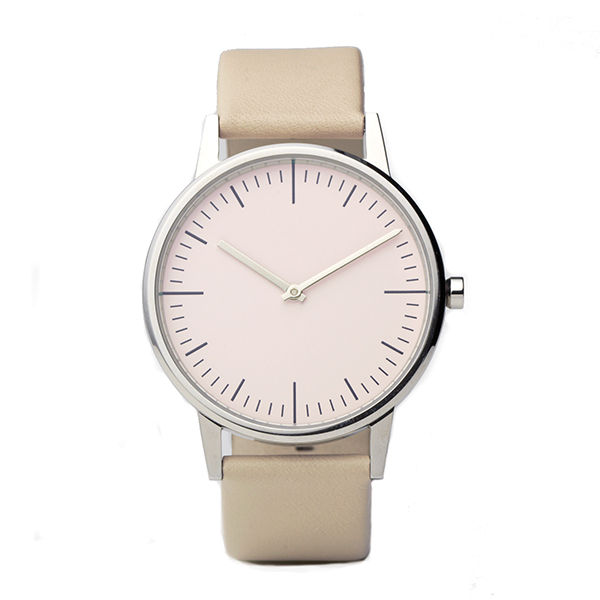 """<h3>150 Series Wrist Watch in Polished/Cream, Uniform Wares, $225</h3> Alissa Parker-Walker: """"Ryan is currently sporting a 200 series wristwatch with a rose gold finish and an Italian calf leather strap… but why should he get all the fun? What I really wa"""