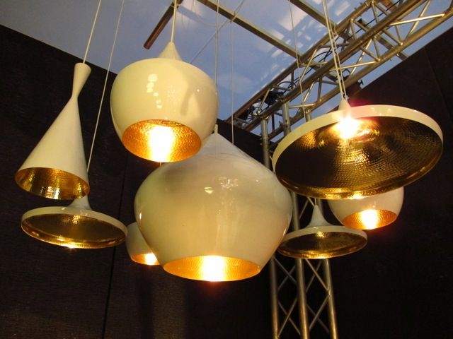 It was a surprise to find Tom Dixon's popular Beat lights, heretofore only finished in matte black' offered in a high-gloss white.