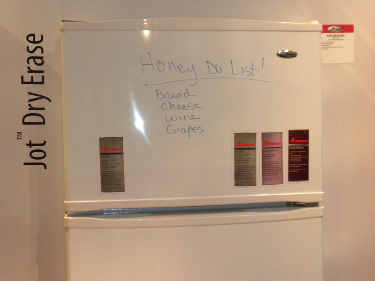 "We've seen many chalkboard walls in kitchens, and this <a href=""http://www.amana.com/"">Amana</a> fridge shares the same principle. The front is not only magnetic but is also a dry erase board, perfect for leaving a note or to-do list."