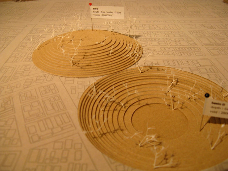 "<a href=""http://www14.plala.or.jp/mfas/fuji.htm"">Masahiro and Mao Harada</a> offer up something much simpler: a set of concave-convex parks created by scooping out huge circles of earth. When a tsunami rolls in, villagers can escape to the manmade hill wh"