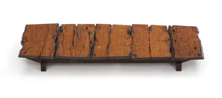 """Motta calls this Aroeira-wood table Jaraguá—""""another beautiful Brazilian Indian name,"""" he says. """"This wood was once part of a post used by the English company Light, when they came to Brazil in 1910 to install power lines from São Paulo to inland towns."""""""