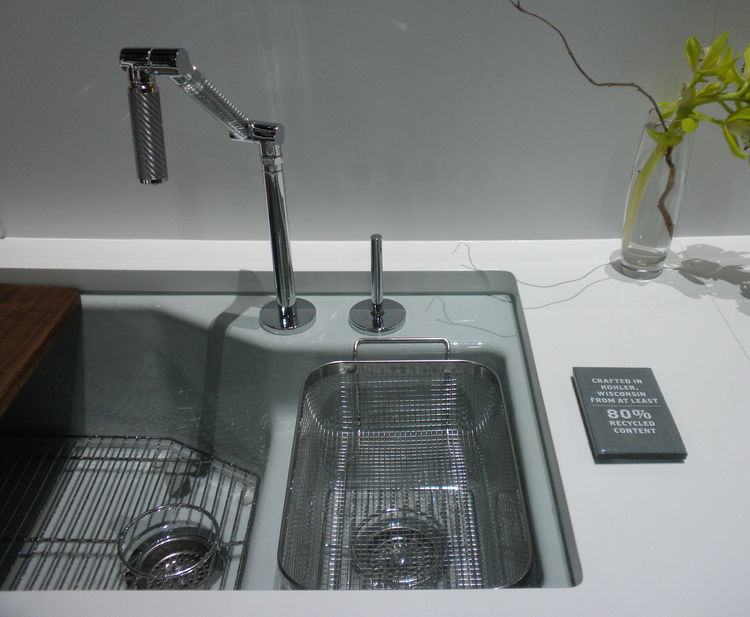 Kohler put its made-in-America and recycled-content cred front and center with plaques reminding attendees of its Wisconsin roots and 80-percent recycled materials in some products.