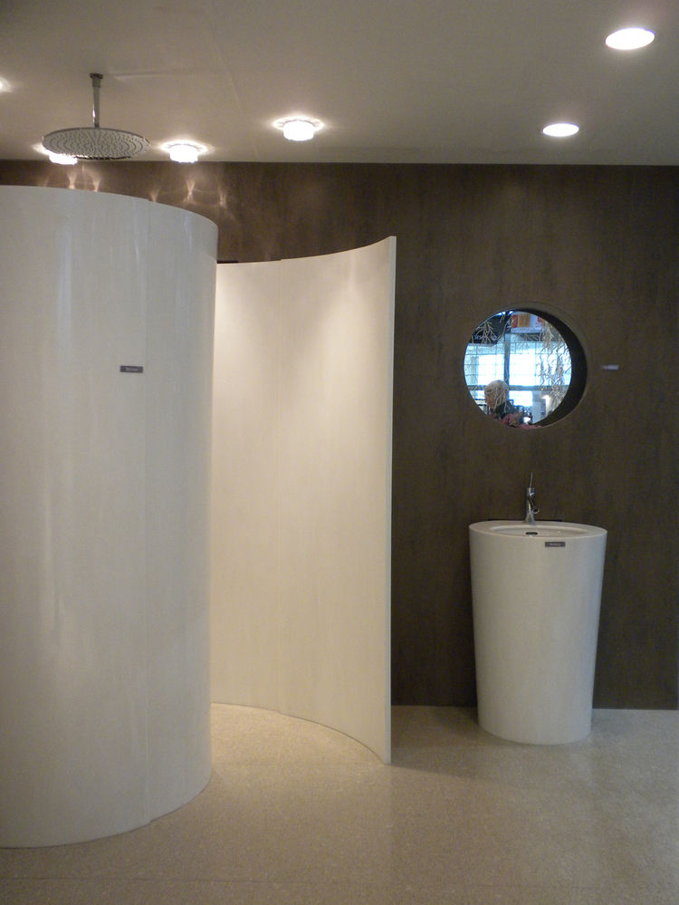 "<a href=""http://www.hanwhasurfaces.com/"">Hanwha</a>, creator of HanStone Quartz and Hanex Solid Surfaces, displayed an innovative use of solid surfaces that become a wrap-around, conch-like shower."