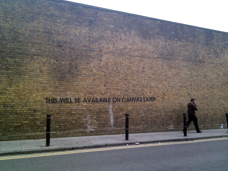 The streets of London, itself, provided wall space for those who didn't want to hire a booth at Earls Court. This jocular example was on a street off Brick Lane in Hackney, East London.