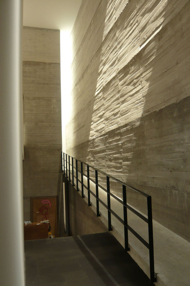 Another great move, and one that felt very Barragan, is this ramp that leads out of the entryway upstairs. The textured concrete has a real gravity, and like Barragan, Muniain deftly uses skylights to offer all kinds of indirect light that only enhances t
