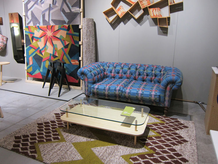 From there, Wilson steered me to the neighboring SCP booth, where her latest designs for the home were on display, including the Munro chesterfield sofa upholstered in her Bora Da fabric and a bunch of rugs, including the dynamic Scope rug leaning against