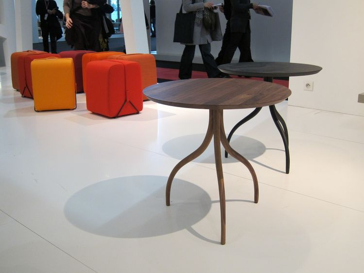 Cleverly, the compact Mobidec pouf by Pierre Charpin comes with its own built-in carrying handle, for easy transport. In the foreground is the Thot table by Pierre Paulin.