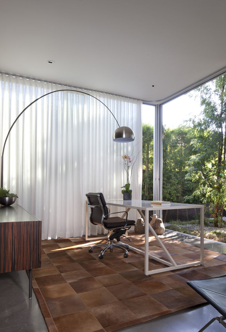 When designing his father's office, Monti made sure his dad had a serene space for getting work done while getting giving a front-row seat to all the action. The office offers generous views of the backyard and all the antics the Monti family are up to in