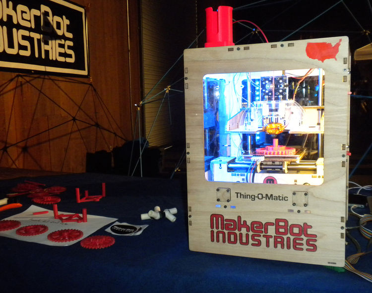 "<a href=""http://www.makerbot.com/"">MakerBots</a> was also exhibiting in the Fiesta Hall, with three Thing-O-Matics on display. The rapid-prototyping machines are robots that melt plastic and reform it into small items like plastic gears of small toys. Mac"