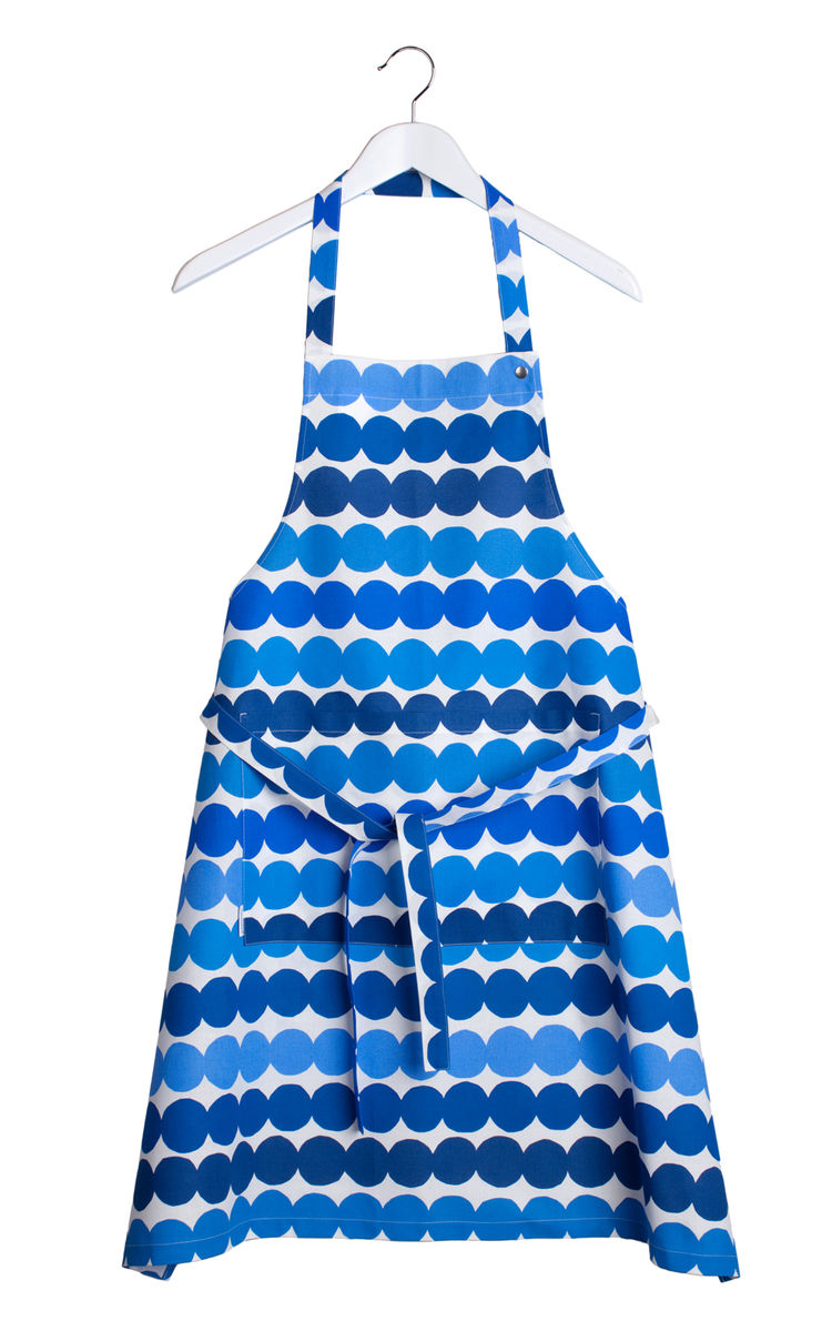 "Here, the blue dots of Louekari's Siirtolapuutarha Räsymatto pattern brighten a white <a href=""http://www.crateandbarrel.com/the-marimekko-shop/marimekko-kitchenwares/marimekko-räsymatto-apron/s199412"">apron</a>."