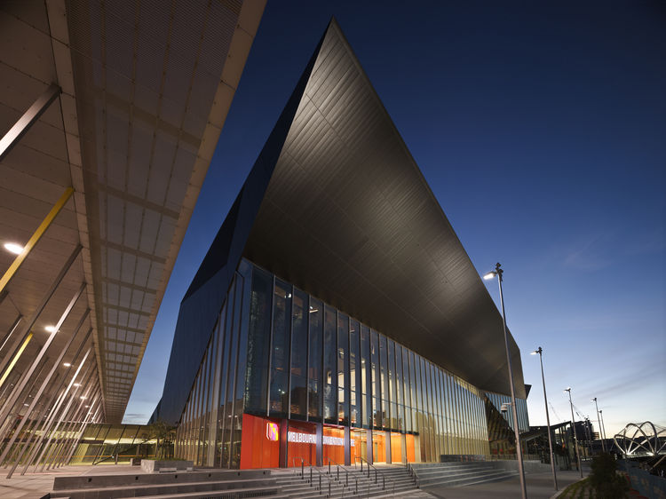 """Though the structure of the Convention Center is steel, it's the black zinc that defines its facade. This huge cantilever extends 40 meters out over the courtyard to provide shelter for any outside exhibitions.<p></p>Image courtesy <a href=""""http://www.dwe"""