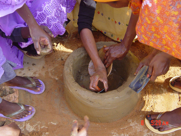 Improved Clay Stove. Practical Action Sudan. Concept: Food and Agriculture Organization of the United Nations and the National Forestry Corporation. Manufactured by Sudanese women networks. Sudan, 2001–present. Clay, animal dung, millet, sorghum chaff. Ph