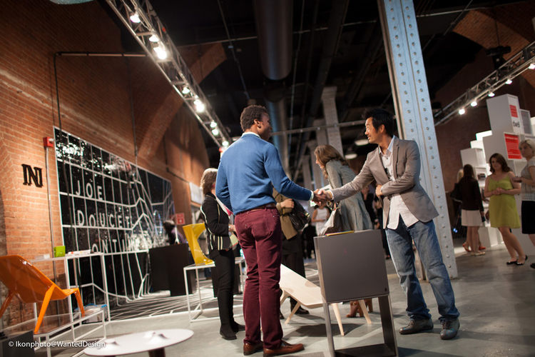 "More from Wanted Design: designer <a href=""http://2012.wanteddesignnyc.com/ini-archibong/"">Ini Archibong</a>, greeting a visitor at his booth."