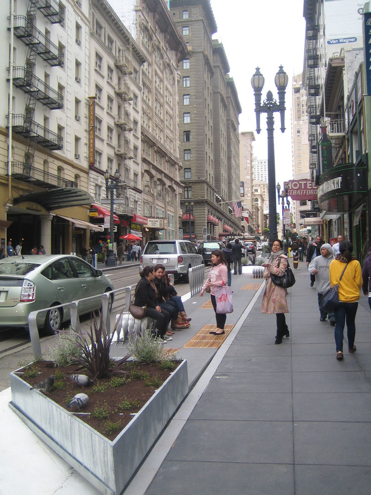 "Here you can see pedestrians already embracing the design. Hood also pointed to a lack of street seating as a problem that he hoped to rectify. And if it turns out that more tables and benches would be nice, ""If we need more benches and tables, we'll just"
