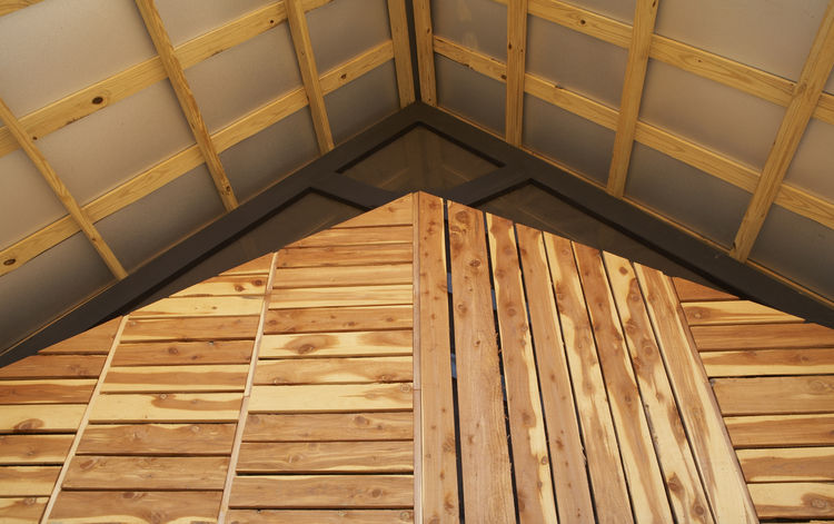 "<p>Grubb and her classmates designed a double-roof system for improved ventilation. The exaggerated overhang protects the home and its residents from the elements.<br /> <br /> Photo by <a href=""http://www.tycole.com"">Ty Cole</a></p>"