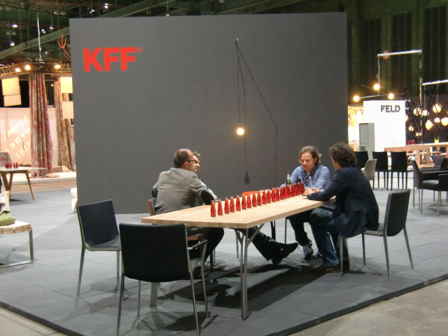 """The gentlemen from Lemgo, Germany's KFF take a break on the award-winning leather and metal """"Unique"""" chairs. Made in Germany, of course. Photo by Sally McGrane."""