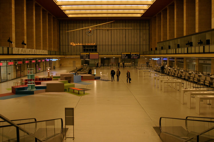Now, Tempelhof's main hall is the departure point for a new kind of voyage. But people still run the wrong way up the people movers when no one is looking.