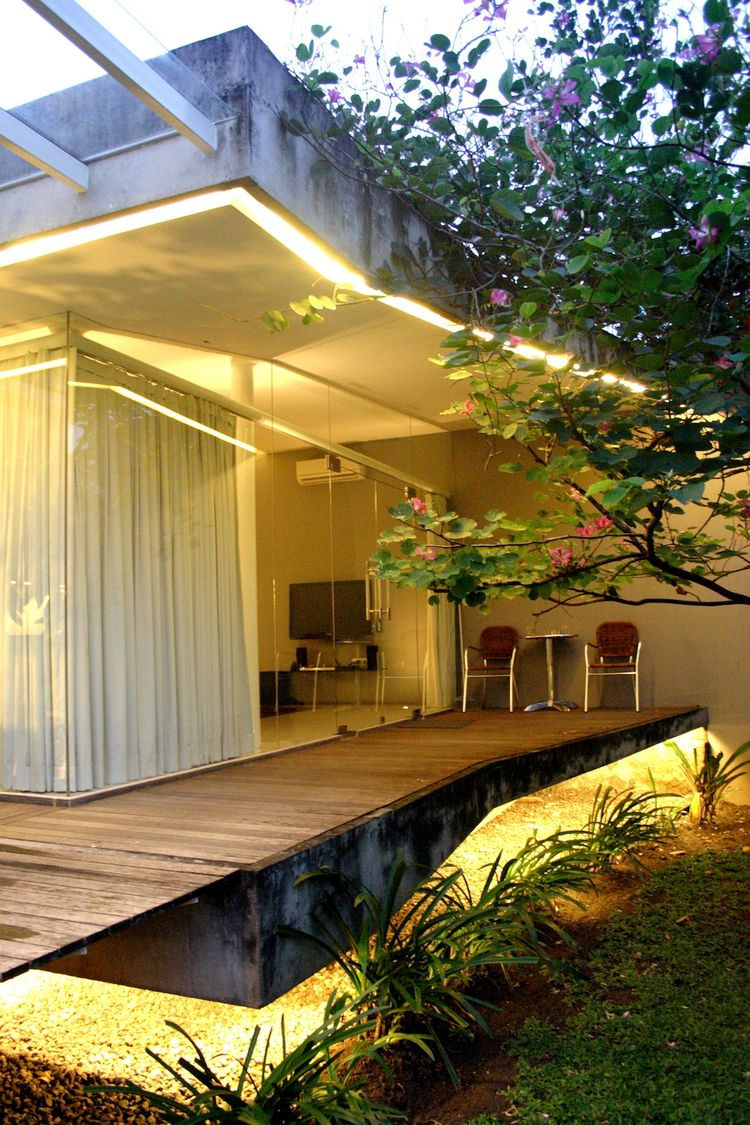 """There's a floating terrace outside the new master bedroom. """"We used a combination of unfinished wood and concrete to express an opposition to the finished Dutch colonial house,"""" says Wibowo."""