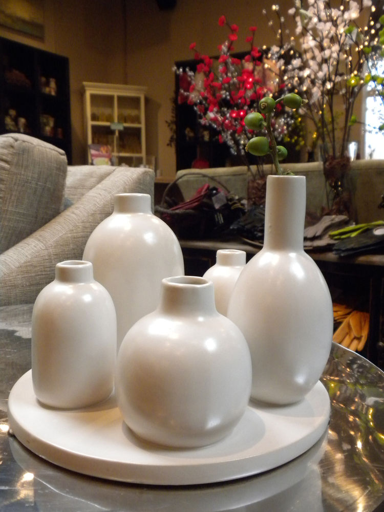 "Though the shop is definitely not a modern design store, it's a cozy place and I spotted some great finds, like this five-vase bud vase by <a href=""http://www.eighteenkarat.com"">18 Karat</a>."