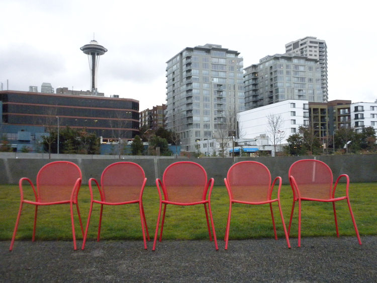 After crossing the bridge, I arrived on the Meadows, a section of the park planted with native grasses and flowers. Though it is here that Alexander Calder's <i>Eagle</i> proudly stands, the bright-red chairs set along the path is what caught my eye the m