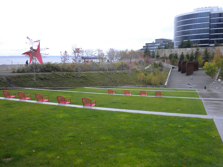 Under protection of the cantilevered roof of the PACCAR Pavilion, it was again the red chairs on the stepped, outdoor amphitheater—as well as Calder's sculpture that matched—that caught my attention. From the distance, Serra's sculpture appears much small