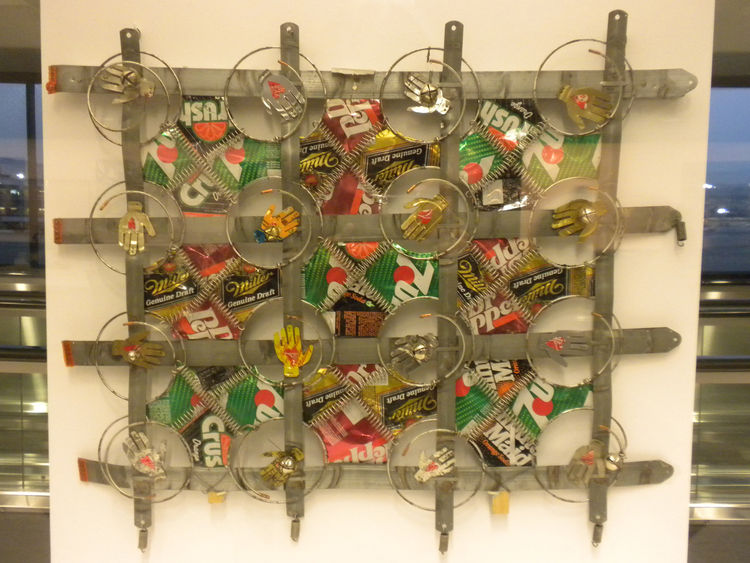 Seattle-based artist Ross Palmer Beecher collects scrap metal and found objects to create what she calls wall quilts. Made by hand, this Box-Spring Quilt incorporates items like metal springs and pop cans to create a wall hanging.