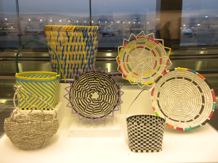 In Southeast Asia, the Hmong make baskets using strips of cane and bamboo. Those who have traveled to the U.S., however, have adapted to local materials. Here, they use inexpensive plastic strapping to continue their traditional practice.