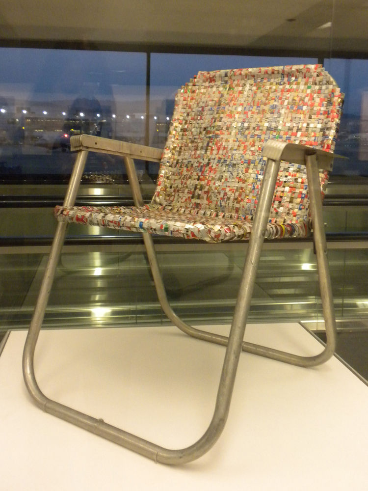 "Writer, inventor, and environmentalist Svein ""Slim"" Sirnes created a tool to cut aluminum cans into strips then proceeded to create sculptures, clothing, purses, lamps, and furniture with the recycled metal. In the early 1990s he created this lawn chair w"