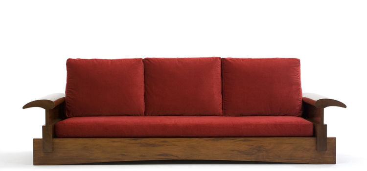 """The Mantiqueiras sofa, designed in 2001 of peroba rosa. """"This is a very low sofa, so you sit very close to the floor,"""" says Motta. """"I made the first one for my house in the mountains, to go right in front the fireplace."""" Photo courtesy <a href=""""http://esp"""