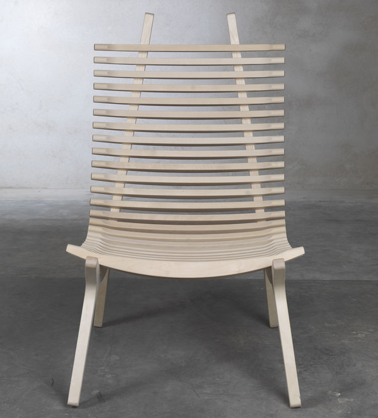 The IBBI lounge chair by designer Nils Gulinis features two distinct parts—  Mirror-image frame supports, which give the chair shape, and 29 sculpted laths that cradle the body, providing the chair with beautiful lines from every perspective. IBBI also ha