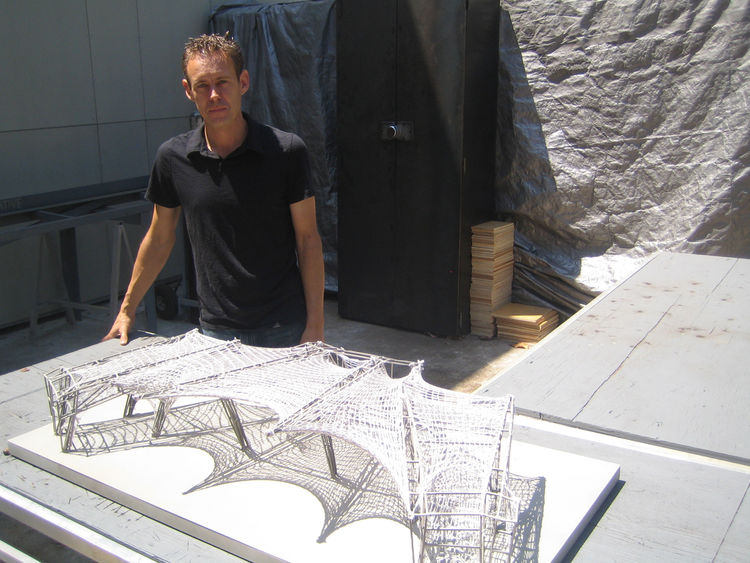 Dwayne Oyler took me out back of his house to show me a graduation pavilion for the Southern California Institute of Architecture that should go under construction next week. It's an impressive model and organized around the principles that underpin knitt