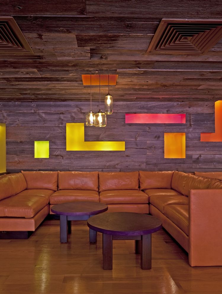 Walking in the bar feels like walking into an old Western saloon, reimagined in a modern way. The walls are paneled with weathered barn siding, with niches painted with wildflower colors like Desert Mariposa Lily, California Poppy, Sunflower, Red Desert G