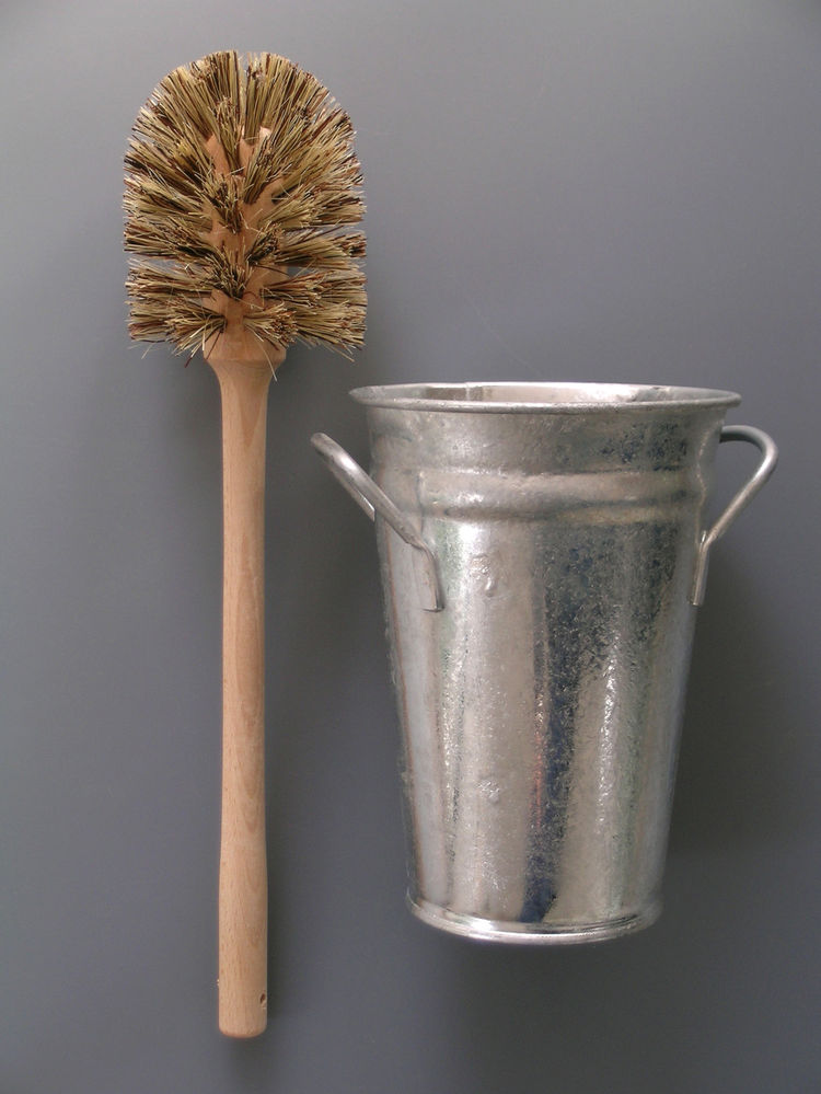 "<b>Toilet Brush and Bucket</b> ""We created this combination as it was impossible to find an attractive and functional toilet set. We like the functional look of the traditional florist's Bucket and traditional wooden brush."" Photo courtesy of Labour and W"