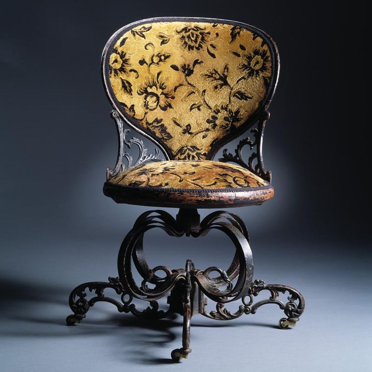 Centripetal Chair designed in 1849. Made of cast iron, lacquered wood, and upholstery. Attributed to the American Chair Company in Troy, New York.