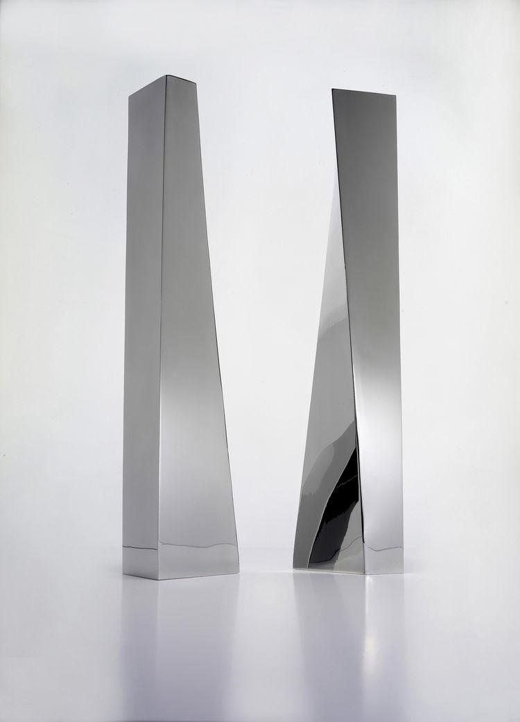 "Crevasse Vases, 2005. Zaha Hadid (Iraqi, b. 1950). Stainless steel. 16 9/16 x 3 1/8 x 2 3/8 in. Silver. ""Crevasse"" design Zaha Hadid, Flower vase in 18/10 stainless steel. Production Alessi Spa, Italy."