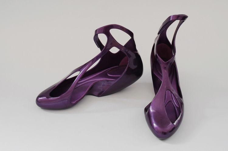 Melissa Shoes, 2008. Zaha Hadid (Iraqi, b. 1950). Mold injected plastic. Black: Women's Size 6: 9 in, Purple: Women's Size 9: 10 in. Black and purple. Made by Grendene S.A., Farroupilha, Rio Grande do Sul, Brazil. Photography courtesy of David Grandorge.