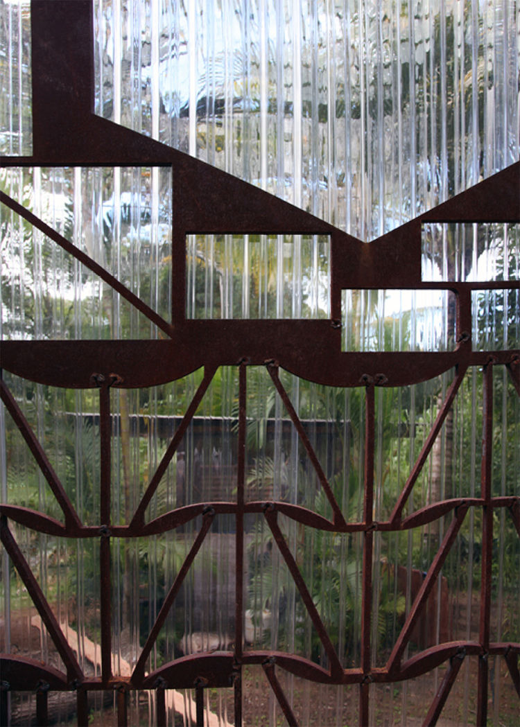 """The kitchen looks out to Sewell's house and his art studio. """"I am particularly fascinated by the random designs of the metal plates after parts have been cut out,"""" he says."""