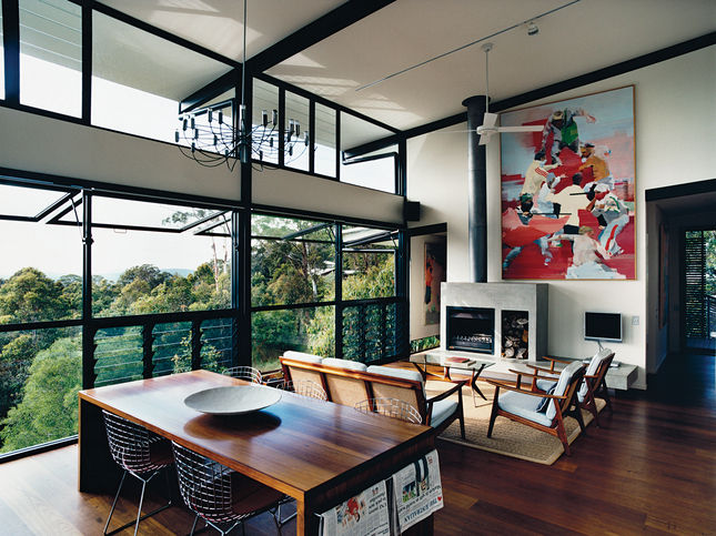 This is their open-plan living, dining, and kitchen area, full of vintage furniture from flea markets. Dunlop's big and bright painting has pride of place over the fireplace.
