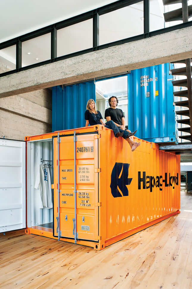 Their solution was to stack two shipping containers on top of each other, to create private space within the open-plan living area.