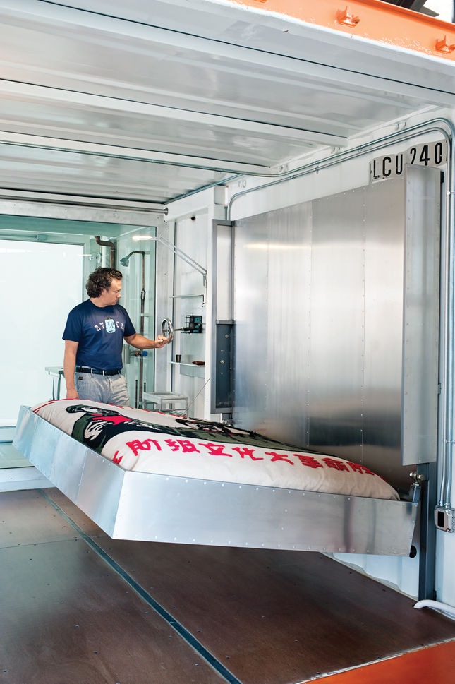 The bottom container contains a guest room with a hand-cranked, custom-made aluminum Murphy bed.