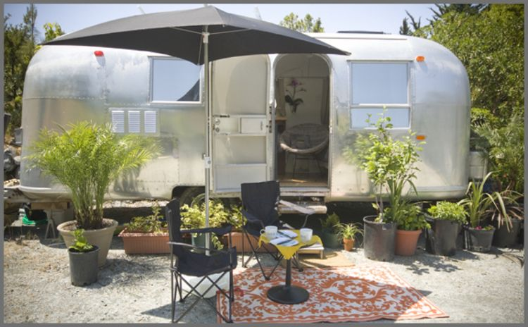 "An exterior view of the finished trailer, installed on site in Big Sur. It's available for <a href=""http://www.bigsurgetaway.com"">nightly rentals</a>."